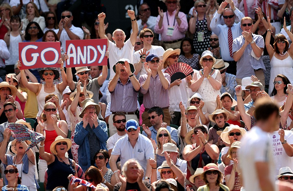Go Andy: Spectators on Centre Court hold a banner aloft displaying a message in support of Andy Murray while others cheer him on