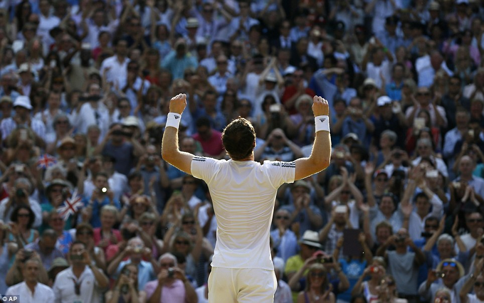 Moment of glory: Andy Murray receives a standing ovation from the crowd after beating Novak Djokovic to become Wimbledon champion