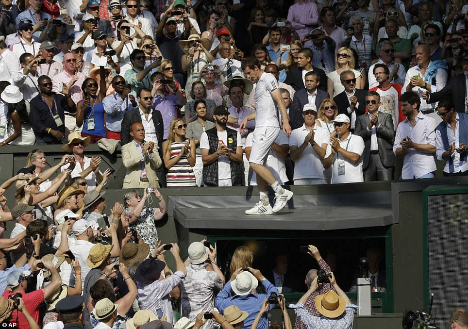 Tradition: Andy Murray walks into the stands to celebrate with relatives and friends after he defeated Novak Djokovic
