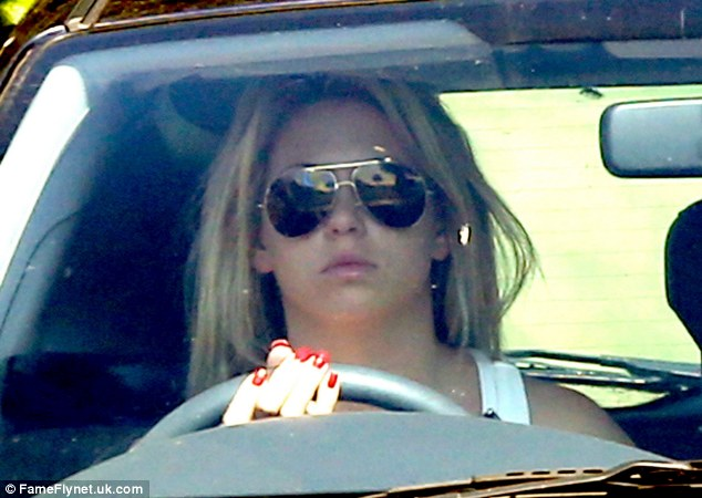 Bianca kept her sunglasses on as she was driving from the converter farmhouse in Berkhamsted in Hertfordshire
