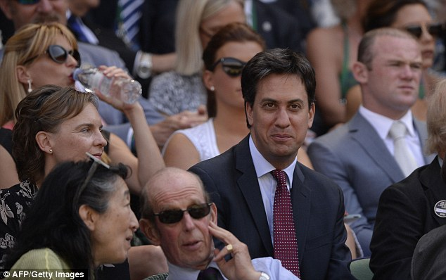 Political heavyweight: Ed Miliband seating a few rows in front of the Rooneys