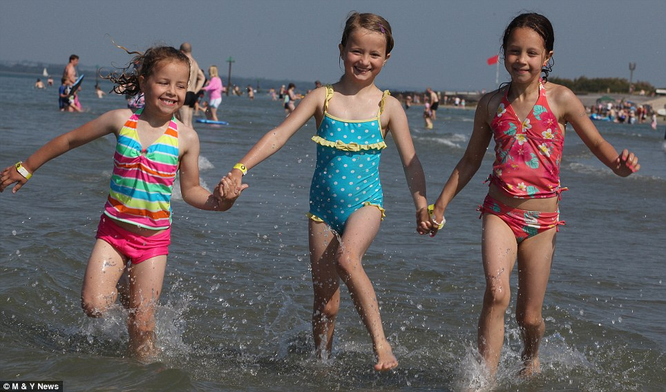 Water babes: Sophia Dickinson,5 , Eve Power and Ella Dickinson, both 10, from Bordon, Hants, in the sea yesterday morning at West Wittering beach, West Sussex