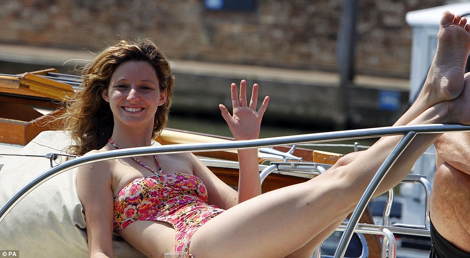 Taking it easy: A spectator on day five of the Royal Henley Regatta enjoys the sunshine yesterday afternoon