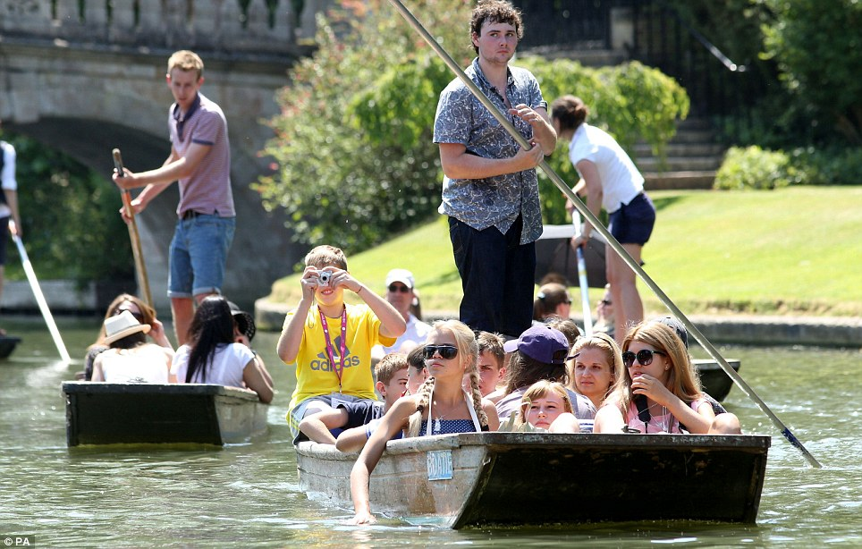 Boat people: Punts make their way along the river Cam in Cambridge as visitors to the city enjoy the summer sunshine