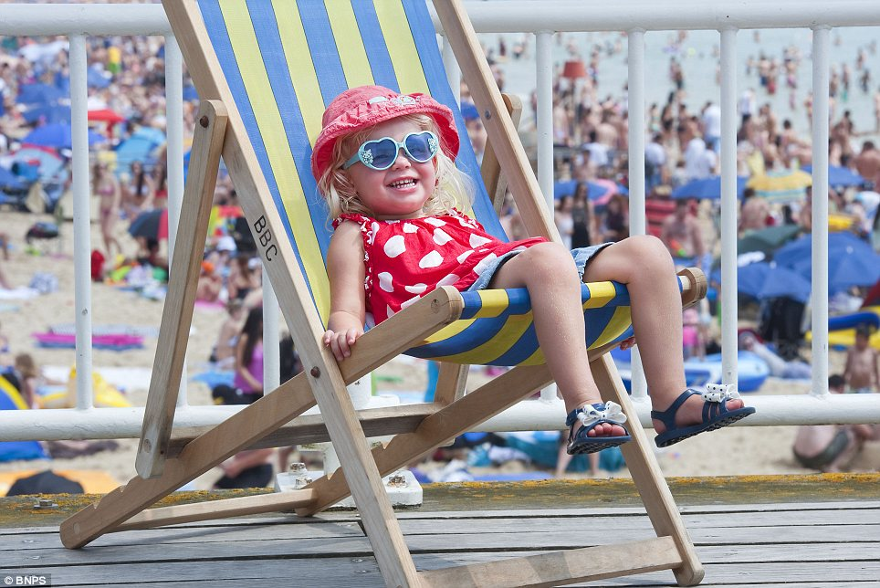 Keeping cool: Two-year-old Charlotte Brown soaks up the sun in a relaxing deckchair on Bournemouth beach