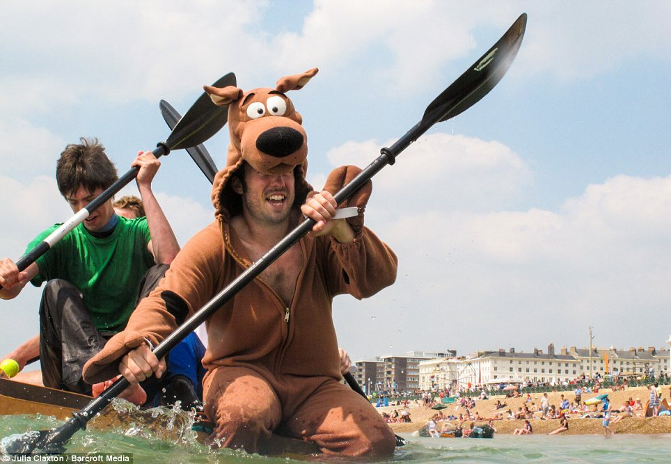 Outfit: A reveller dressed as Scooby-Doo took part in the paddling competition