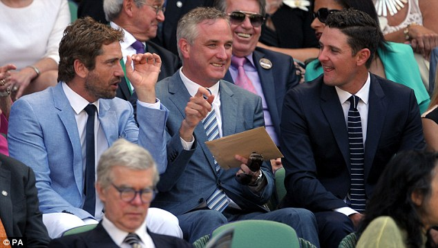 Talking tennis: Gerard also chatted to Justin Rose at the game