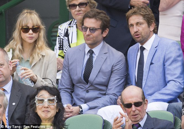 Blossoming bromance? Bradley also made time for pal Gerard Butler, who sat on his left