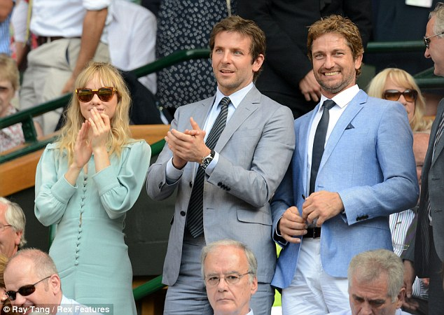 Celebration: The trio stand up to applaud Andy following his win