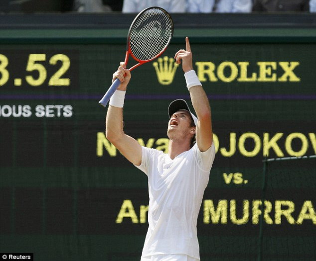 Making history: Murray celebrates winning the first set on the way to his historic victory
