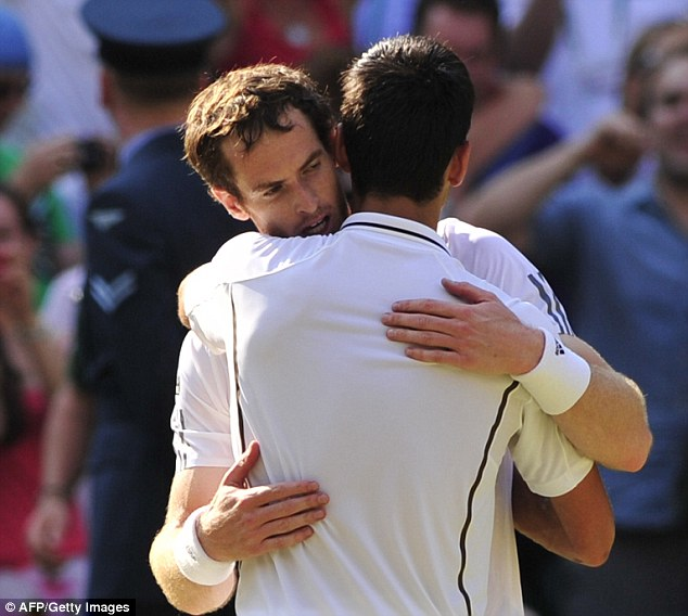 Tough battle: A exhausted Murray embraces opponent Novak Djokovic after the heroic straight sets win