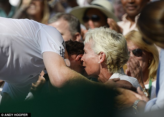 Family affair: Murray embraces mother Judy as she cries tears of joy after her son's victory