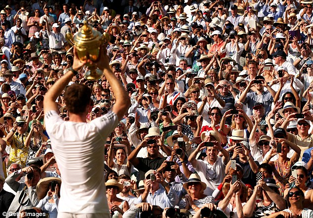 Adulation: Murray lifts the famous trophy in front of the adoring Centre Court crowd after his win