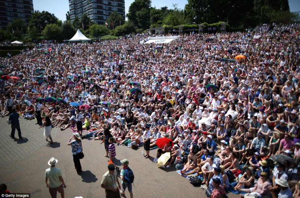 Big draw: The crowd grows silent as tensions mount in Wimbledon and Murray looks close to winning a set