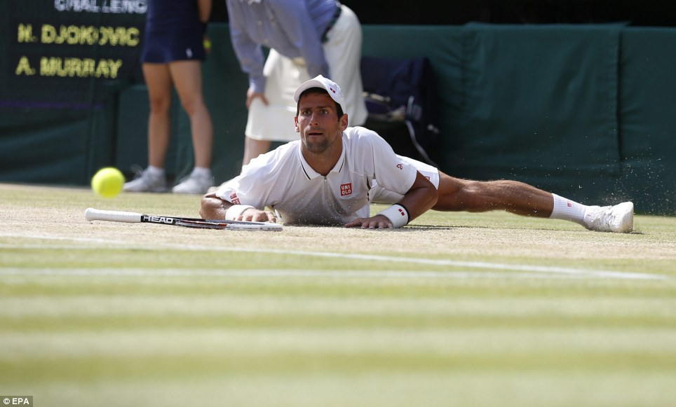 Split game: Djokovic looks frustrated as he falls to the ground and fails to return to Andy Murray