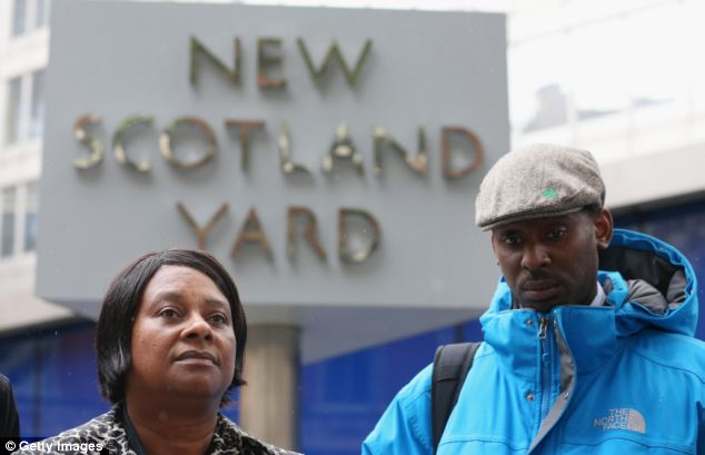 Smear claims:  Doreen Lawrence, the mother of Stephen Lawrence, outside New Scotland Yard with her son Stuart after meeting with Sir Bernard Hogan-Howe