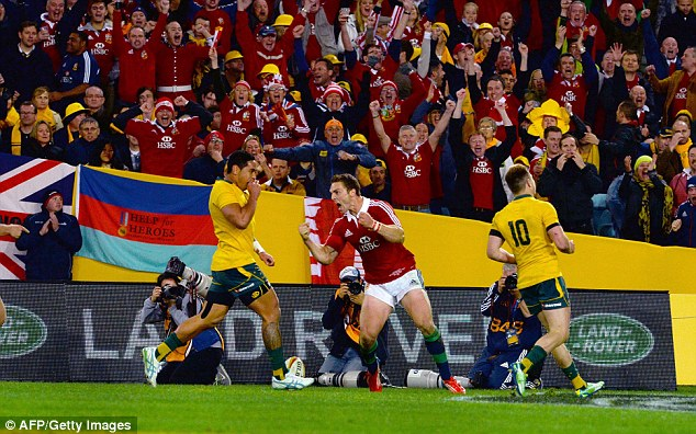 To the line: George North scored one of four tries for the Lions in their crushing victory in Sydney