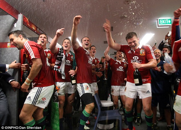 Shower time: The champagne sprayed in the Lions dressing room as they celebrated their success