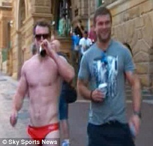 Party time: Stuart Hogg took to the streets in his swimming trunks to celebrate on Sunday