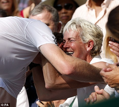 Britain's Andy Murray hugs his mother Judy Murray after climbing into the players box to celebrate