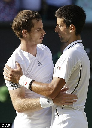 Sportsmanship and glory: Murray is congratulated by Novak Djokovic of Serbia after their hard-fought battle