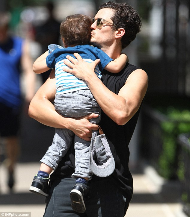 Daddy's boy: Flynn spent some time out with father Orlando Bloom on Saturday in the Big Apple