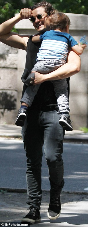 I'm off duty: The toddler was a little more shy and retiring during his outing with daddy