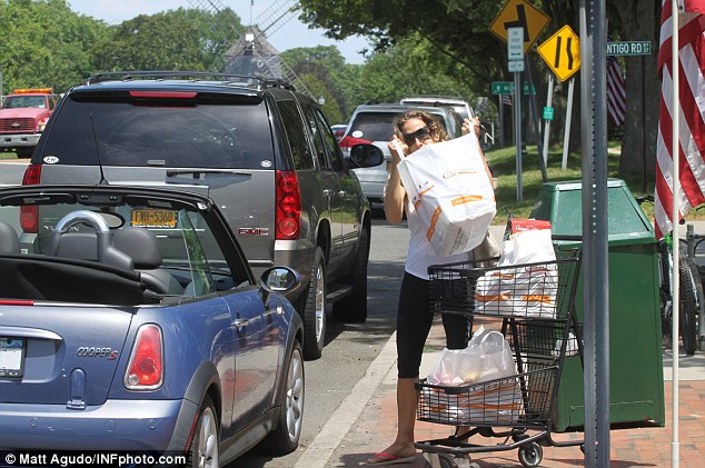 Heavy-lifting: Sarah Jessica Parker was spotted unloading her own groceries into her Mini Cooper convertible in the Hamptons, New York on Sunday