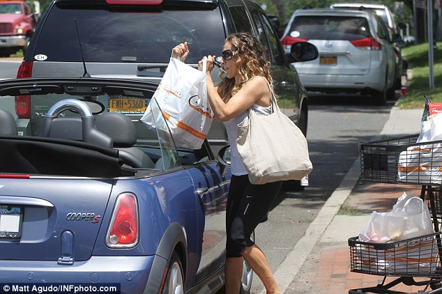 Fighting fit: Sarah Jessica donned black workout pants and a white vest top, perhaps having fit in a visit to the gym prior to her shop