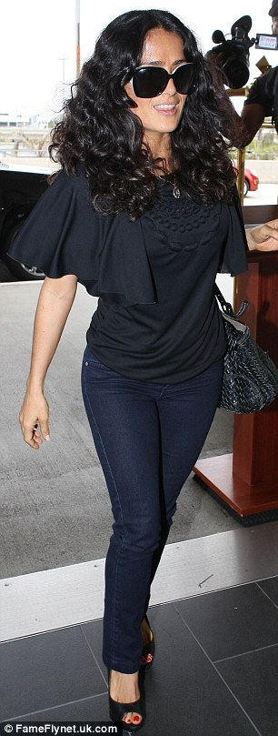 Latina beauty: Salma Hayek was also spotted at LAX wearing skintight jeans and a frilly black top on Sunday