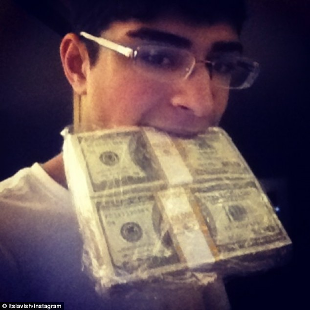 One of your five-a-day? Lavish posted this picture of himself biting into a wad of cash with the caption 'Mama always told me to eat my greens bitch'