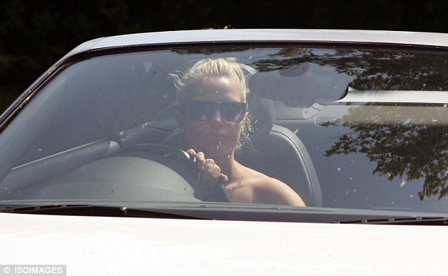 Quick exit: Helen then jumped into her white Audi R8 and zoomed off to continue the rest of her day