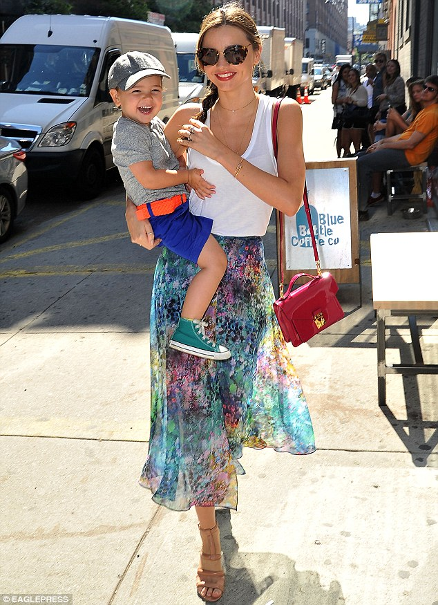 That's funny! Miranda Kerr's little man Flynn was full of giggles as he ventured out with her supermodel mother on Monday in New York