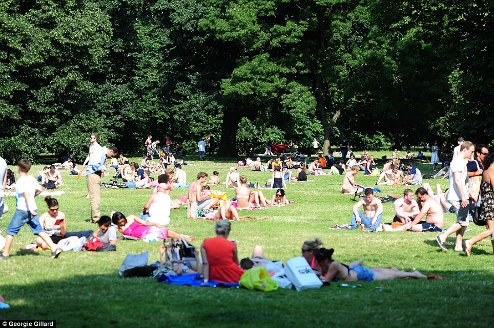 Summertime: Hyde Park in central London was packed full of people bathing in the sun yesterday on the hottest day of the year so far