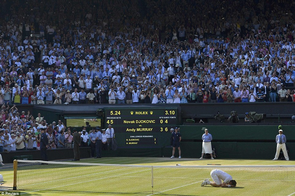 Unbelievable: On his knees, head in hands, Murray is overcome by his achievement at the end of his dramatic match against Novak Djokovic of Serbia