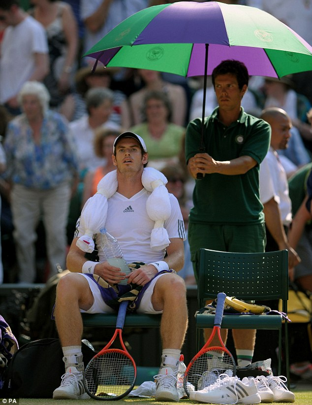 Pressure point: Murray sits with a towel of ice round his shoulders, one game away from becoming Wimbledon champion