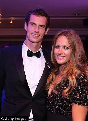 Perfect pair: Murray with his girlfriend Kim Sears who has been ever present by his side during Wimbledon