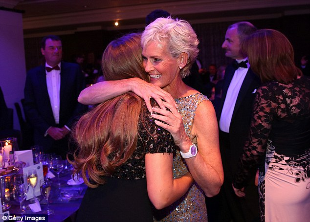 We did it: Mum Judy gives girlfriend Kim a hug as their man's achievement starts to sink in