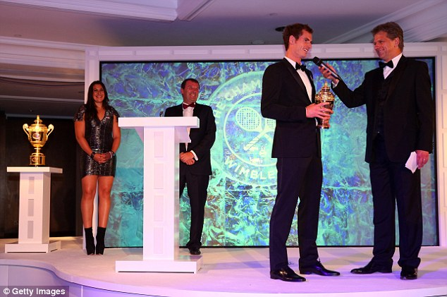 All smiles: Murray has his audience in raptures as he takes questions from Andrew Castle at the glitzy dinner