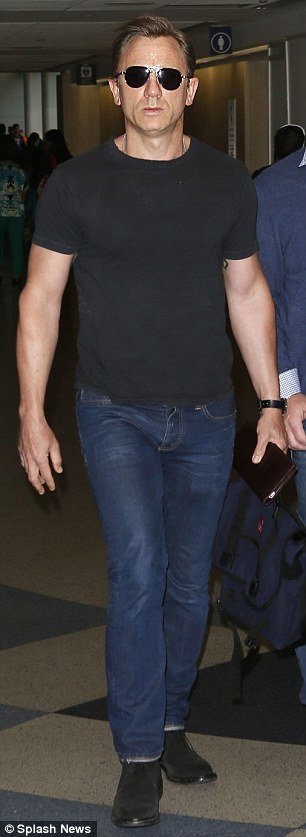 man of steel: Daniel Craig also touched down at LAX on Sunday, showing off his buff arms in a fitted black T-shirt paired with jeans