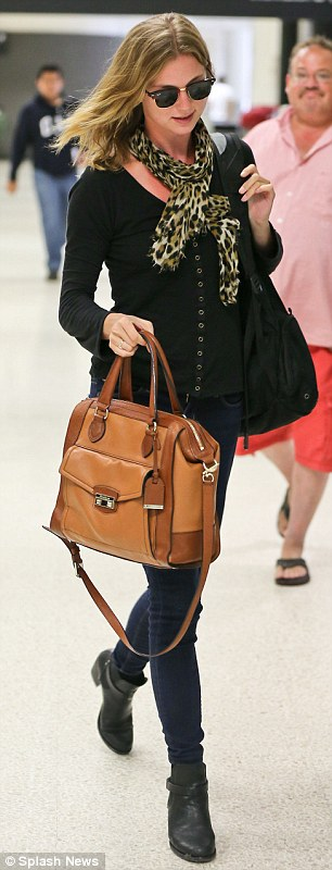 Tres chic: Emily VanCamp looked stylish in tight jeans and boots as she arrived at LAX from Toronto on Sunday