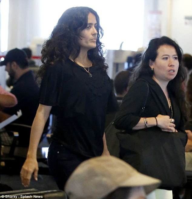 Keeping it simple: Salma appeared to be wearing minimal makeup and accessorised with a delicate pendant around her neck