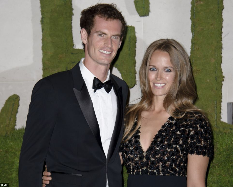 Strike a pose: Andy Murray with Kim Sears, his partner of seven years arriving at the ball