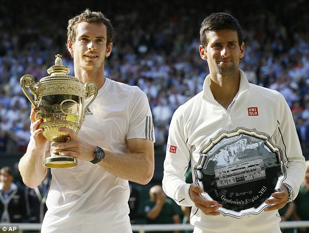 On court: Murray, 26, becomes the first Brit to hold the male winner's trophy in 77 years after he beat world number one Novak Djokovic (right)