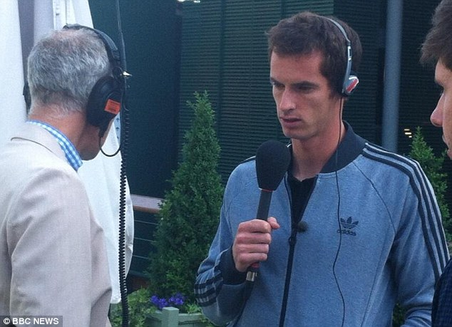 Morning after: Andy Murray carries out an interview with the BBC Radio 4 Today show after dramatically winning Wimbledon yesterday
