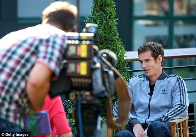 Champion: Andy Murray carries out a series of television interviews today after becoming the first British man to win Wimbledon in 77 years