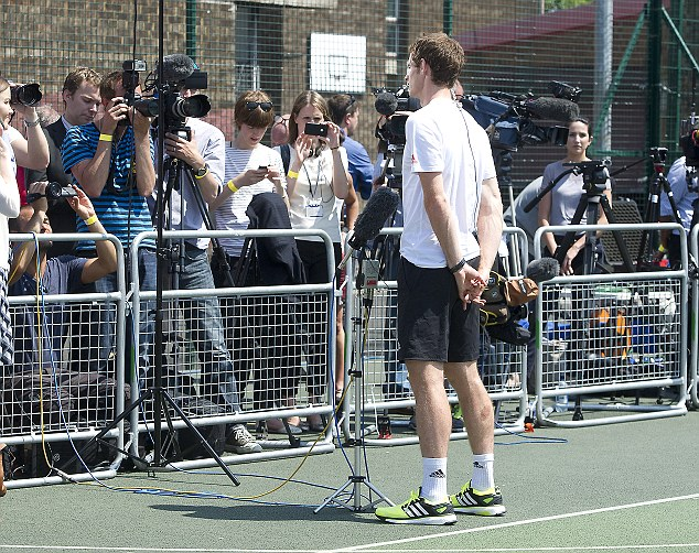Intense interest: Andy Murray carries out yet another media interview today as he celebrates winning Wimbledon