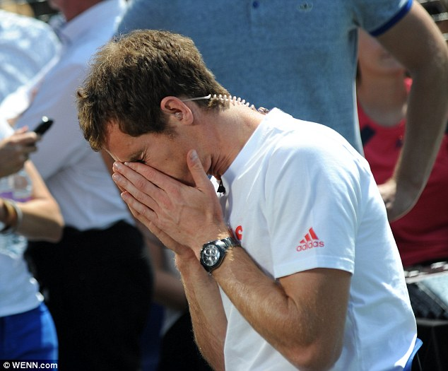 Exhausted: Andy Murray only got one hour of sleep last night before he was back doing media interviews this morning after his historic victory