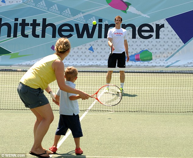 Beating a champion: A young boy attempts to return a winner against Andy Murray at an event in south London today