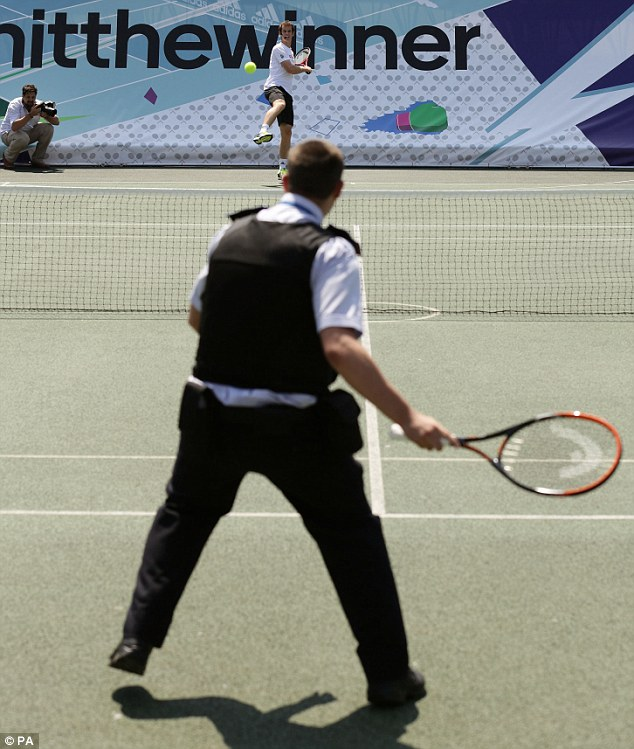 Hit the winner: Andy Murray plays a point with PCSO Craig Venables during the Adidas event in Kennington, south London, today